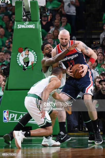 Marcin Gortat of the Washington Wizards handles the ball against the Boston Celtics during Game Seven of the Eastern Conference Semifinals of the...
