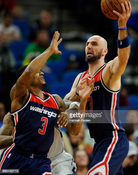 Marcin Gortat of the Washington Wizards holds onto the ball as teammate Bradley Beal looks on during the second quarter of the game on March 13 2017...