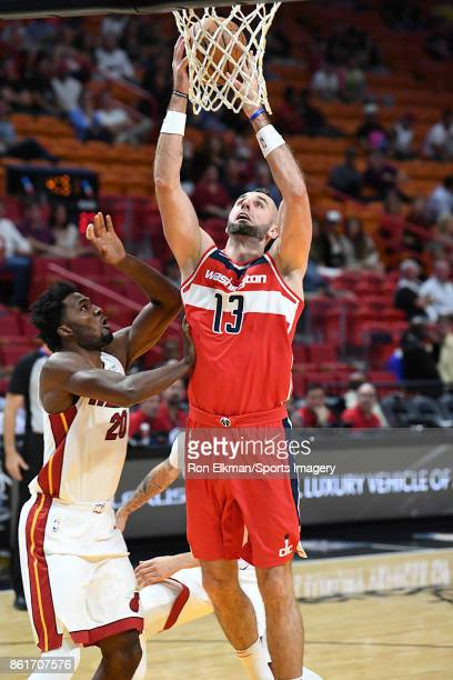 Marcin Gortat of the Washington Wizards in action during a preseason game against the Miami Heat at American Airlines Arena on October 11 2017 in...