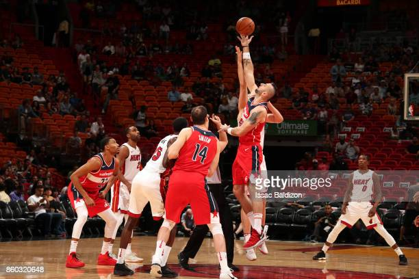 Marcin Gortat of the Washington Wizards jumps for the tip off at the start of the preseason game against the Miami Heat at the American Airlines...
