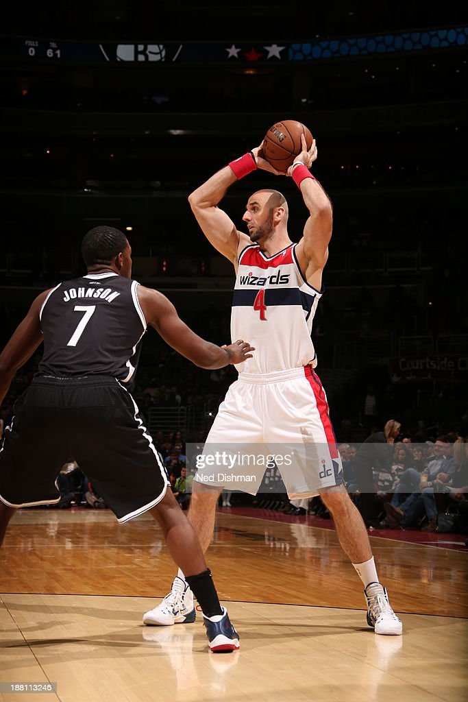 <a gi-track='captionPersonalityLinkClicked' href=/galleries/search?phrase=Marcin+Gortat&family=editorial&specificpeople=589986 ng-click='$event.stopPropagation()'>Marcin Gortat</a> #4 of the Washington Wizards looks to pass against the Brooklyn Nets at the Verizon Center on November 8, 2013 in Washington, DC.