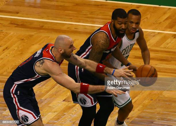 Marcin Gortat of the Washington Wizards passes the ball in front of Markieff Morris and Avery Bradley of the Boston Celtics during Game Seven of the...