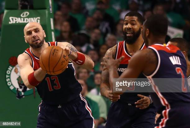 Marcin Gortat of the Washington Wizards passes the ball to John Wall against the Boston Celtics during Game Seven of the NBA Eastern Conference...