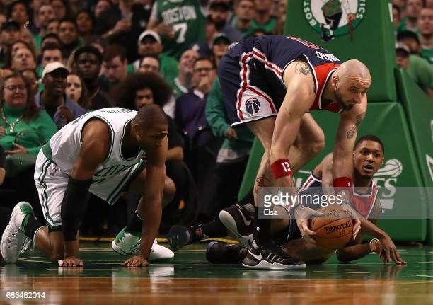 Marcin Gortat of the Washington Wizards picks up a loose ball against Al Horford of the Boston Celtics during Game Seven of the NBA Eastern...