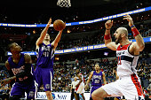 Marcin Gortat of the Washington Wizards reacts to a call as Ben McLemore and Kosta Koufos of the Sacramento Kings go for the ball late in the fourth...