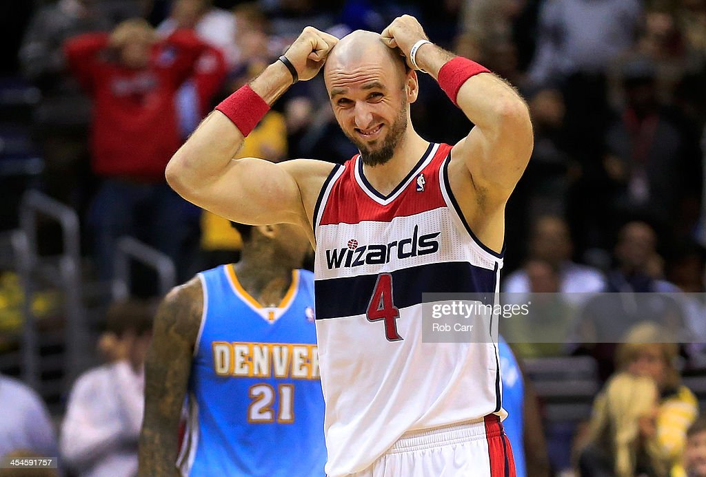 <a gi-track='captionPersonalityLinkClicked' href=/galleries/search?phrase=Marcin+Gortat&family=editorial&specificpeople=589986 ng-click='$event.stopPropagation()'>Marcin Gortat</a> #4 of the Washington Wizards reacts to a play during the closing minute of the Wizards 75-74 loss to the Denver Nuggets at Verizon Center on December 9, 2013 in Washington, DC.