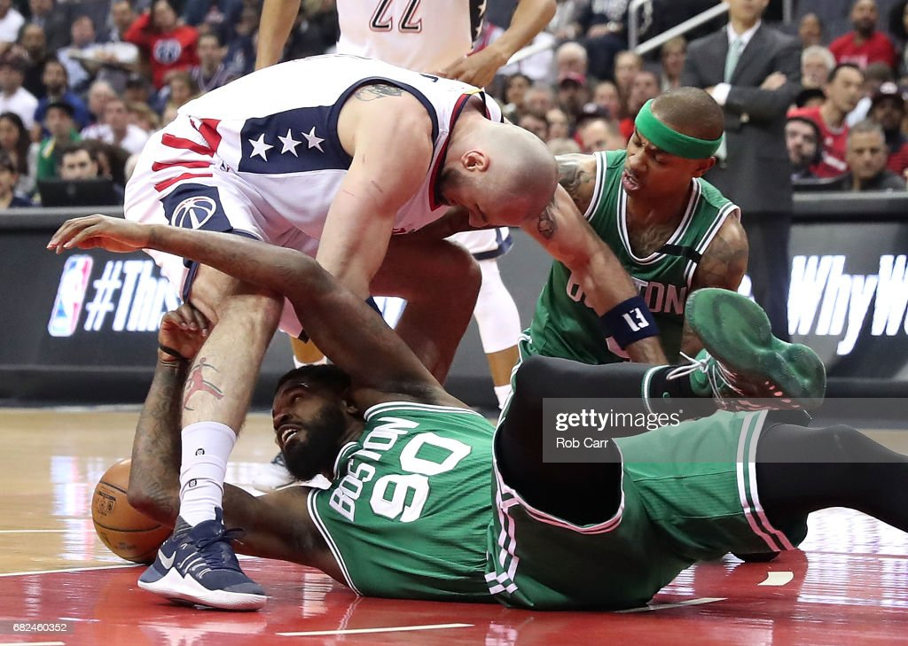 Marcin Gortat #13 of the Washington Wizards scrambles for a loose ball against Amir Johnson #90 and Isaiah Thomas #4 of the Boston Celtics during Game Six of the NBA Eastern Conference Semi-Finals at Verizon Center on May 12, 2017 in Washington, DC.