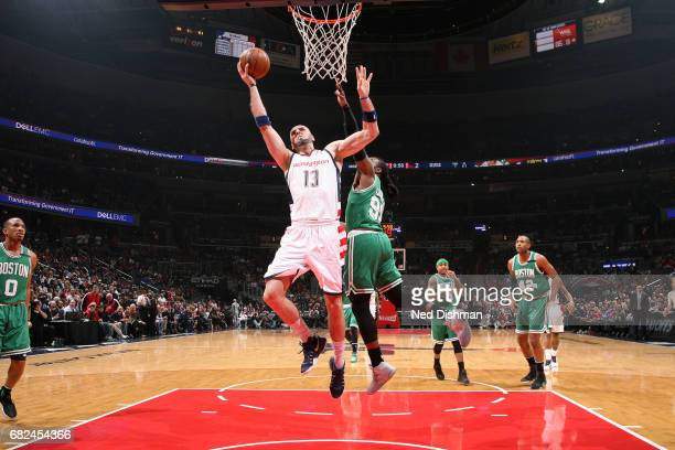 Marcin Gortat of the Washington Wizards shoots a lay up during the game against the Boston Celtics during Game Six of the Eastern Conference...