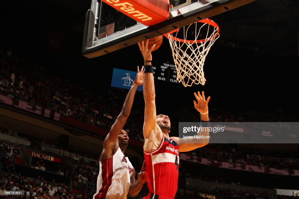 <a gi-track='captionPersonalityLinkClicked' href=/galleries/search?phrase=Marcin+Gortat&family=editorial&specificpeople=589986 ng-click='$event.stopPropagation()'>Marcin Gortat</a> #4 of the Washington Wizards shoots against <a gi-track='captionPersonalityLinkClicked' href=/galleries/search?phrase=Chris+Bosh&family=editorial&specificpeople=201574 ng-click='$event.stopPropagation()'>Chris Bosh</a> #1 of the Miami Heat on November 3, 2013 at American Airlines Arena in Miami, Florida.