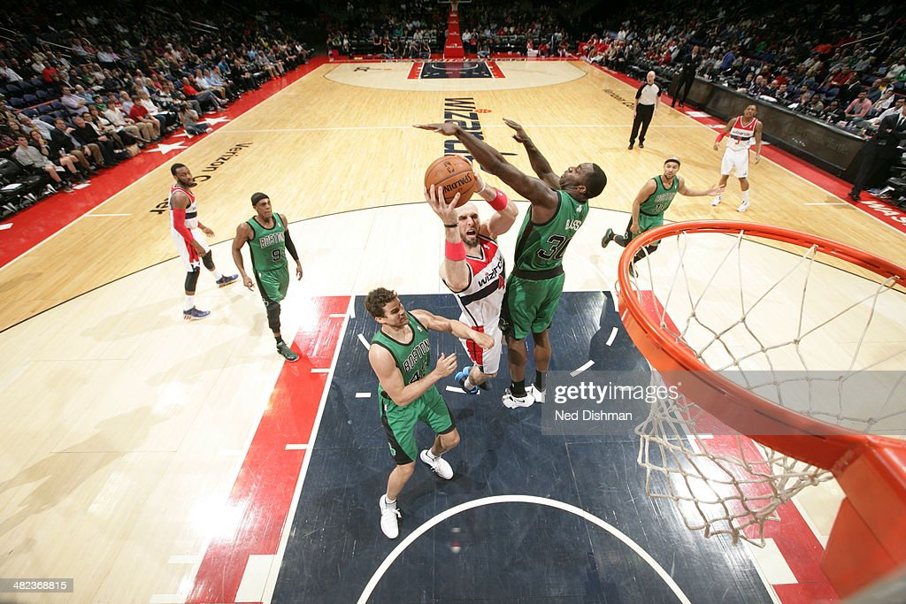 <a gi-track='captionPersonalityLinkClicked' href=/galleries/search?phrase=Marcin+Gortat&family=editorial&specificpeople=589986 ng-click='$event.stopPropagation()'>Marcin Gortat</a> #4 of the Washington Wizards shoots against the Boston Celtics at the Verizon Center on April 2, 2014 in Washington, DC.