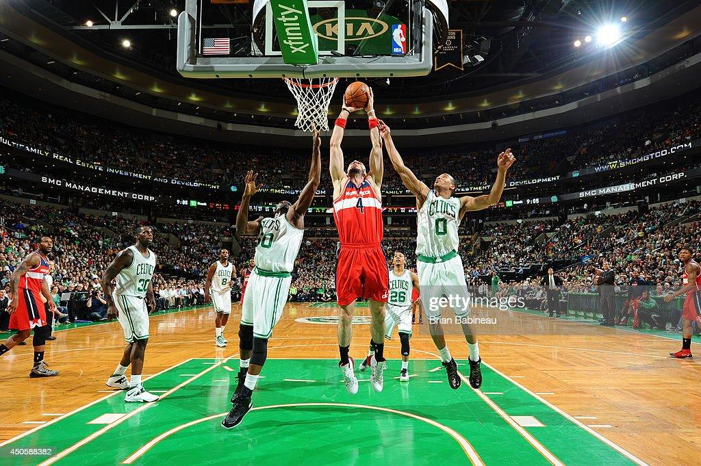 Marcin Gortat #4 of the Washington Wizards shoots against the Boston Celtics on April 16, 2014 at the TD Garden in Boston, Massachusetts.