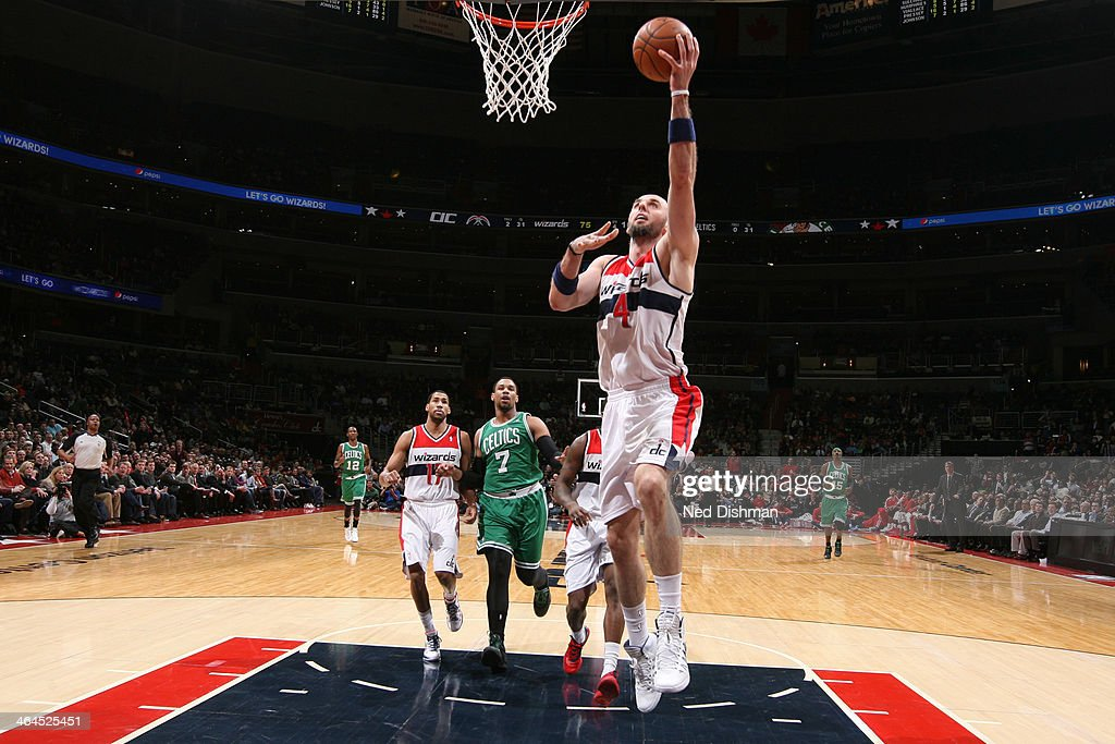 <a gi-track='captionPersonalityLinkClicked' href=/galleries/search?phrase=Marcin+Gortat&family=editorial&specificpeople=589986 ng-click='$event.stopPropagation()'>Marcin Gortat</a> #4 of the Washington Wizards shoots against the Boston Celtics during the game at the Verizon Center on January 22, 2014 in Washington, DC.