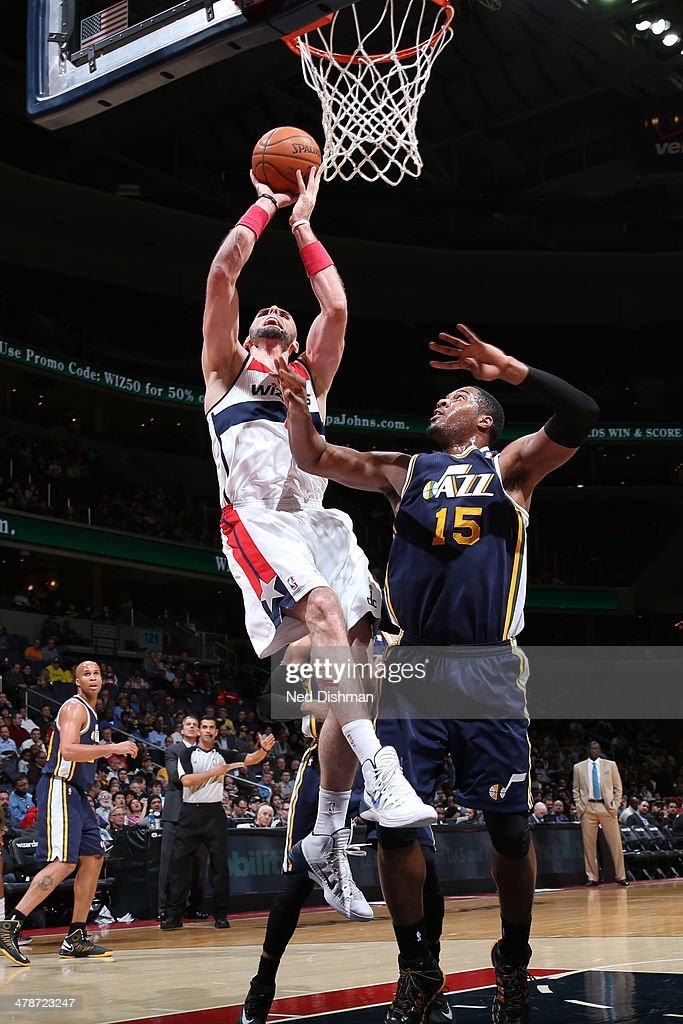 <a gi-track='captionPersonalityLinkClicked' href=/galleries/search?phrase=Marcin+Gortat&family=editorial&specificpeople=589986 ng-click='$event.stopPropagation()'>Marcin Gortat</a> #4 of the Washington Wizards shoots against the Utah Jazz at the Verizon Center on March 5, 2014 in Washington, DC.