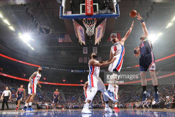 Marcin Gortat of the Washington Wizards shoots the ball against the Detroit Pistons on April 10 2017 at The Palace of Auburn Hills in Auburn Hills...