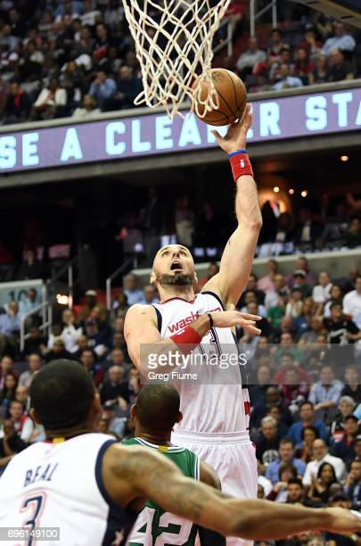 Marcin Gortat of the Washington Wizards shoots the ball against the Boston Celtics in Game Three of the Eastern Conference Semifinals at Verizon...