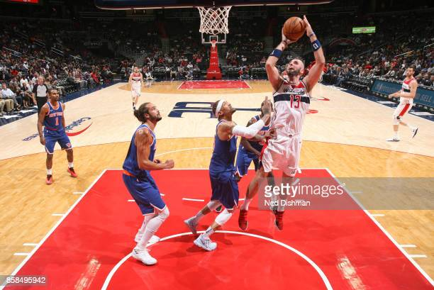 Marcin Gortat of the Washington Wizards shoots the ball against the New York Knicks during the preseason game on October 6 2017 at Capital One Arena...