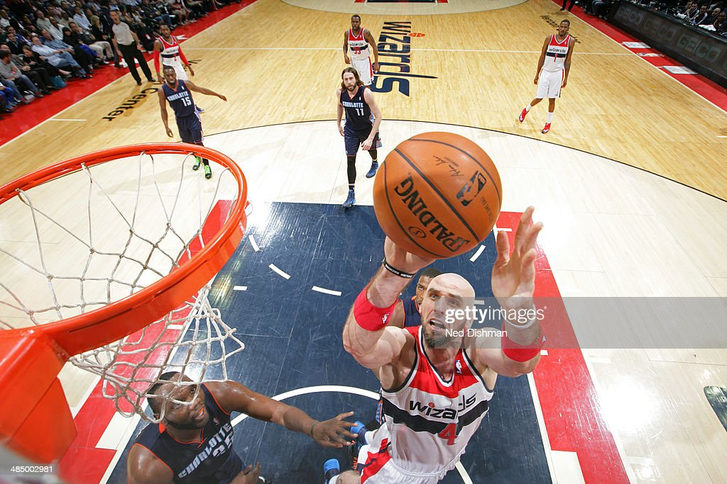 <a gi-track='captionPersonalityLinkClicked' href=/galleries/search?phrase=Marcin+Gortat&family=editorial&specificpeople=589986 ng-click='$event.stopPropagation()'>Marcin Gortat</a> #4 of the Washington Wizards takes a shot against the Charlotte Bobcats at the Verizon Center on April 9, 2014 in Washington, DC.
