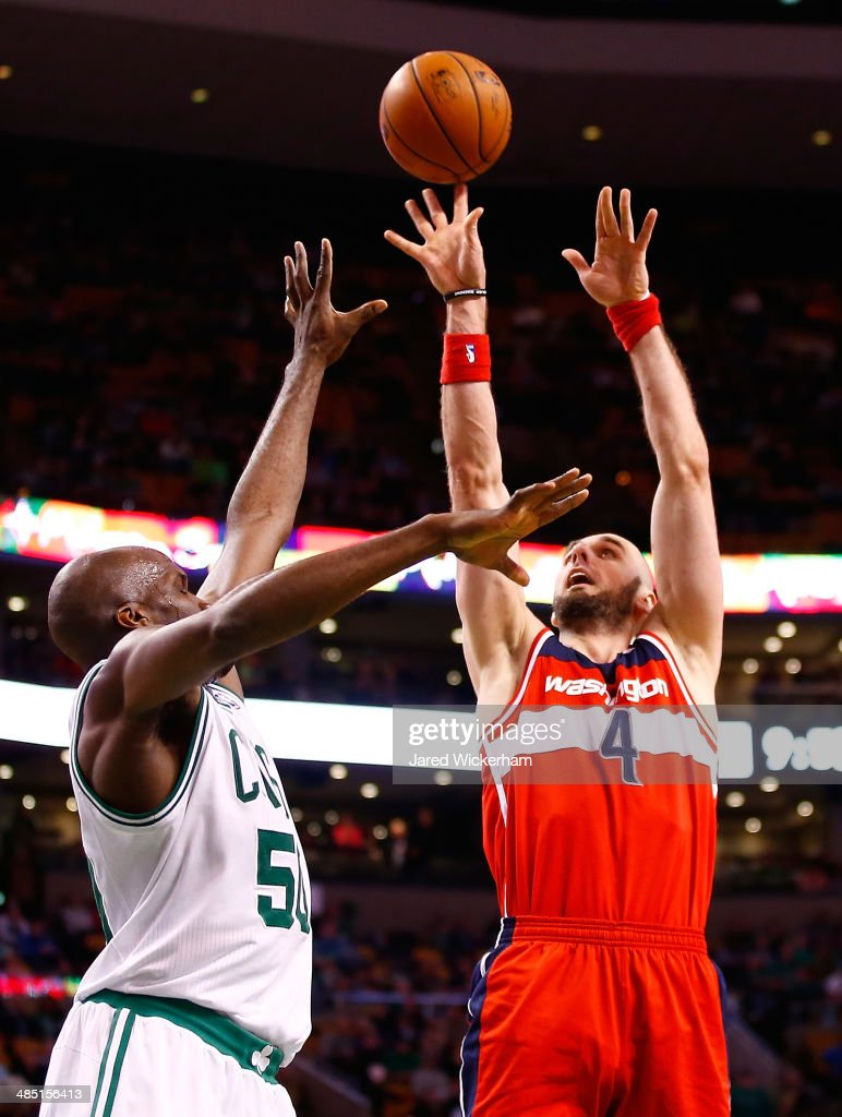Marcin Gortat #4 of the Washington Wizards takes a shot over Joel Anthony #50 of the Boston Celtics in the second half during the game at TD Garden on April 16, 2014 in Boston, Massachusetts.