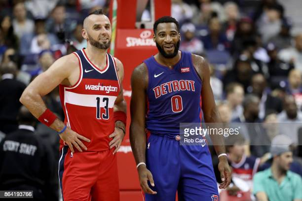 Marcin Gortat of the Washington Wizards talks with Andre Drummond of the Detroit Pistons at Capital One Arena on October 20 2017 in Washington DC...