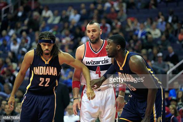 Marcin Gortat of the Washington Wizards waits between Chris Copeland and Roy Hibbert of the Indiana Pacers during a free throw attempt during the...