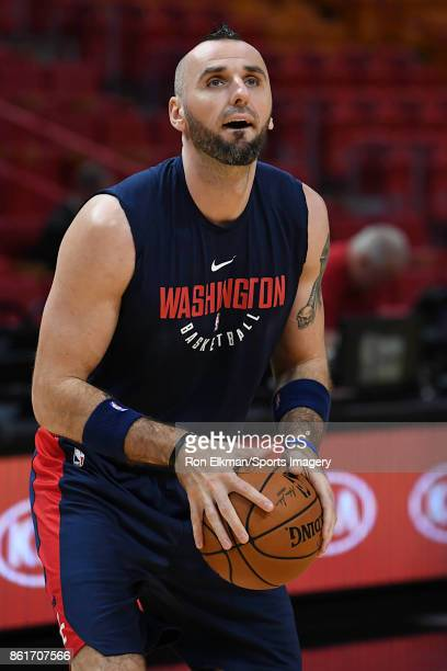 Marcin Gortat of the Washington Wizards warms up before a preseason game against the Miami Heat at American Airlines Arena on October 11 2017 in...