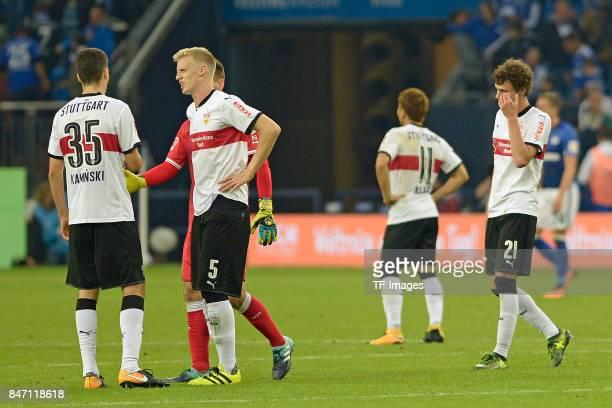Marcin Kaminski of Stuttgart and Timo Baumgartl of Stuttgart and Benjamin Pavard of Stuttgart looks dejected during the Bundesliga match between FC...