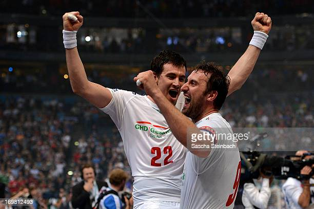 Marcin Lijewski and Igor Vori of Hamburg celebrate the championship after the EHF Final Four final match between FC Barcelona Intersport and HSV...