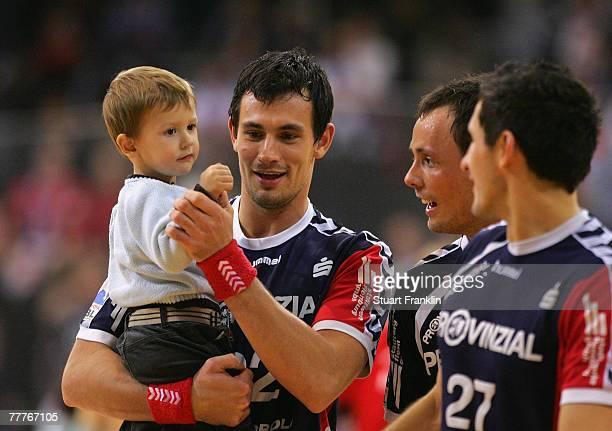 Marcin Lijewski of Flensburg celebrates with his son and teamates at the end of the Bundesliga Handball game between SG FlensburgHandewitt and HSG...