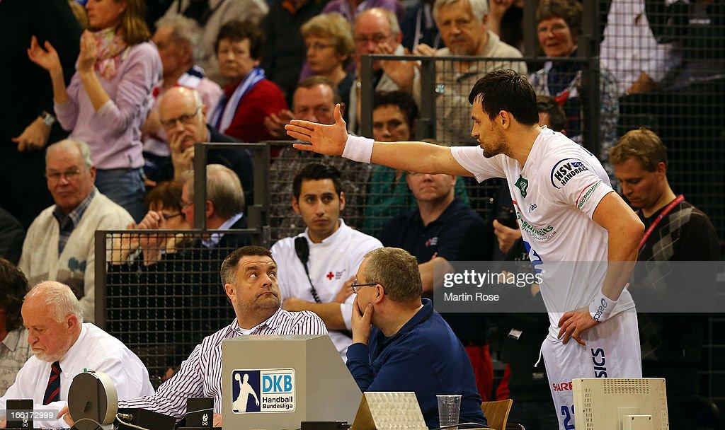 Marcin Lijewski of Hamburg argues with the judges after he gets the red card during the DKB Handball Bundesliga match between SG Flensburg-Handewitt and HSV Hamburg at Flens Arena on April 9, 2013 in Flensburg, Germany.