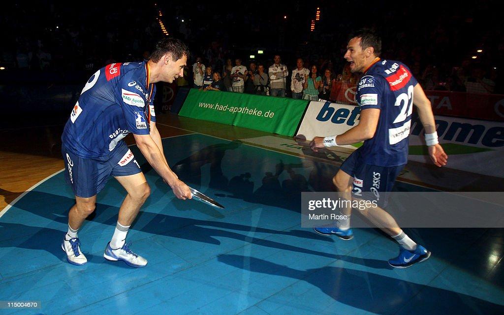 Marcin Lijewski of Hamburg celebrate with team mate Krzystof Lijewski after the Toyota Handball Bundesliga match between HSV Hamburg and TBV Lemgo at...