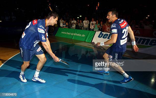 Marcin Lijewski of Hamburg celebrate with team mate Krzystof Lijewski after the Toyota Handball Bundesliga match between HSV Hamburg and TBV Lemgo at...