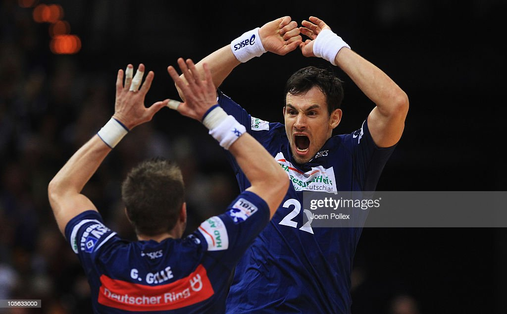 Marcin Lijewski of Hamburg celebrates with his team mate <a gi-track='captionPersonalityLinkClicked' href=/galleries/search?phrase=Guillaume+Gille&family=editorial&specificpeople=609796 ng-click='$event.stopPropagation()'>Guillaume Gille</a> after scoring for his team during the Toyota Handball Bundesliga match between HSV Hamburg and Fuechse Berlin at the o2 World Arena on October 17, 2010 in Hamburg, Germany.