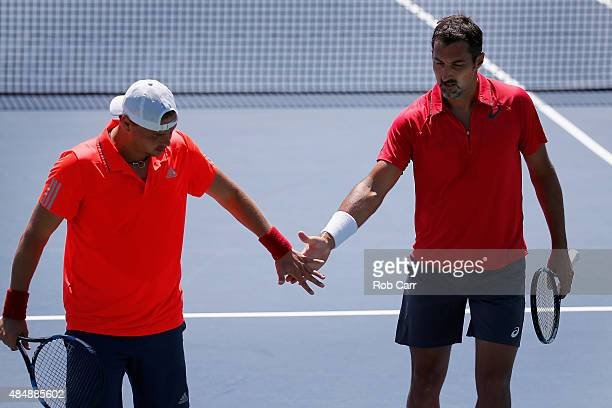 Marcin Matkowski of Poland and Nenad Zimonjic of Serbia celebrate a point against Ivan Dodig Croatia and Marcelo Melo of Brazil during the men's...