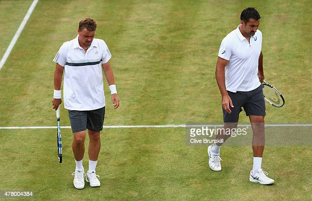 Marcin Matkowski of Poland and Nenad Zimonjic of Serbia look dejected during their men's doubles final against Nicolas Mahut and PierreHugues Herbert...