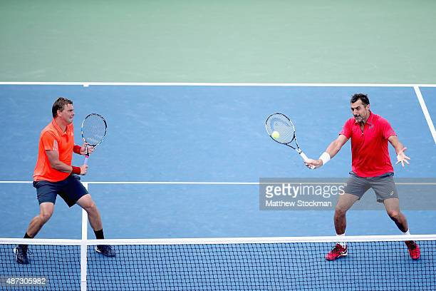 Marcin Matkowski of Poland and Nenad Zimonjic of Serbia return a shot against Jamie Murray of Great Britain and John Peers of Australia during their...
