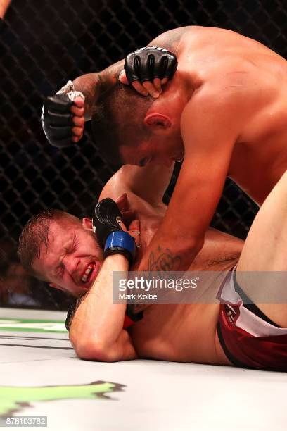 Marcin Tybura of Poland and Fabricio Werdum of Brazil wrestle in their heavyweight bout during the UFC Fight Night at Qudos Bank Arena on November 19...