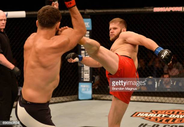 Marcin Tybura of Poland kicks Andrei Arlovski of Belarus in their heavyweight bout during the UFC Fight Night event at the Singapore Indoor Stadium...