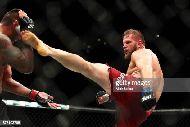 Marcin Tybura of Poland kicks Fabricio Werdum of Brazil in their heavyweight bout during the UFC Fight Night at Qudos Bank Arena on November 19 2017...