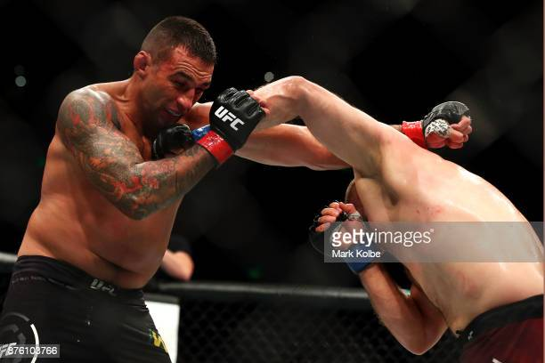 Marcin Tybura of Poland punches Fabricio Werdum of Brazil in their heavyweight bout during the UFC Fight Night at Qudos Bank Arena on November 19...