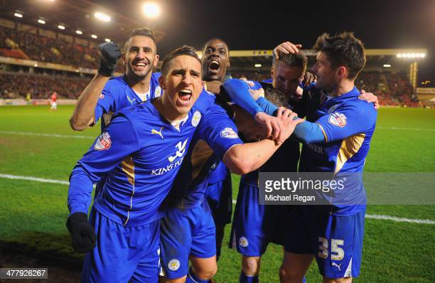 Marcin Wasilewski Anthony Knockaert Jeffrey Schlupp Jamie Vardy and David Nugent of Leicester celebrate with Daniel Drinkwater after he scores to...