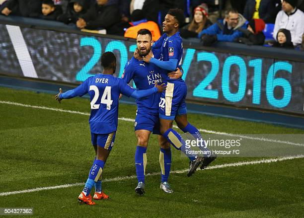 Marcin Wasilewski of Leicester City celebrates with Nathan Dyer and Demarai Gray as he scores their first and equalising goal during the Emirates FA...