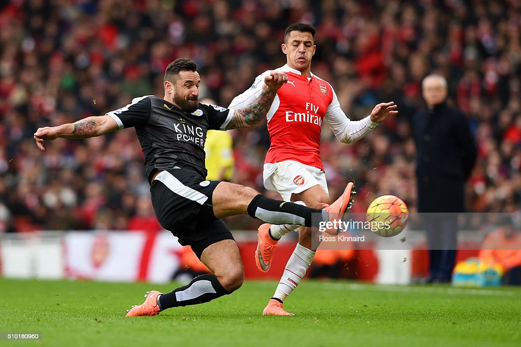 <a gi-track='captionPersonalityLinkClicked' href=/galleries/search?phrase=Marcin+Wasilewski&family=editorial&specificpeople=2155872 ng-click='$event.stopPropagation()'>Marcin Wasilewski</a> of Leicester City slides in to clear the ball from <a gi-track='captionPersonalityLinkClicked' href=/galleries/search?phrase=Alexis+Sanchez&family=editorial&specificpeople=5515162 ng-click='$event.stopPropagation()'>Alexis Sanchez</a> of Arsenal during the Barclays Premier League match between Arsenal and Leicester City at Emirates Stadium on February 14, 2016 in London, England.