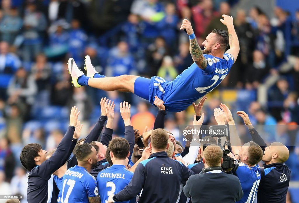 Marcin Wasilewski of Leicester receives the bumps from his team mates after calling time on his Leicester City career after the Premier League match between Leicester City and Bournemouth at King Power Stadium on May 21 , 2017 in Leicester, United Kingdom.