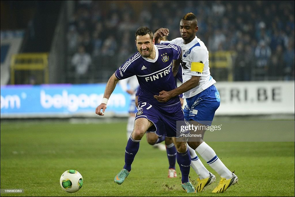 Marcin Wasilewski of RSC Anderlecht and Mboyo Ilombe of KAA Gent in action during the Cofidis Cup match between Rsc Anderlecht and Kaa Gent on January 16, 2013 in Anderlecht , Belgium.