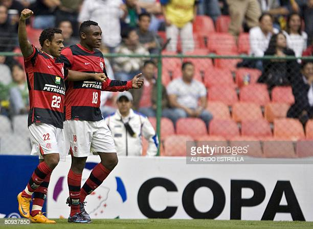 Marcinho of Brazilian Flamengo celebrates with his teammate Manuel de Brito after making a goal against Mexican America during their Libertadores Cup...