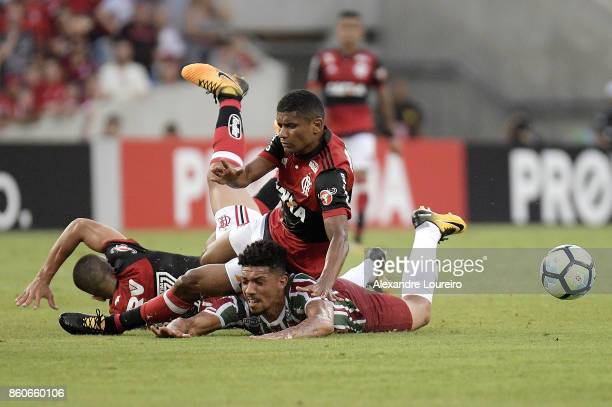 Marcio Araujo of Flamengo battles for the ball with Douglas of Fluminense during the match between Flamengo and Fluminense as part of Brasileirao...