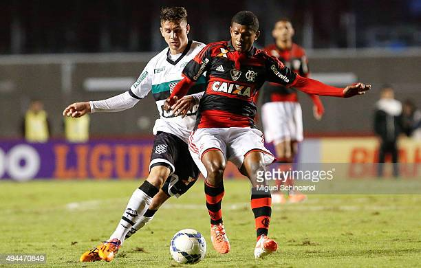 Marcio Araujo of Flamengo fights for the ball with Everaldo of Figueirense during a match between Flamengo and Figueirense of Brasileirao Series A...