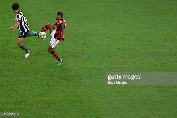Marcio Araujo of Flamengo struggles for the ball with Camilo of Botafogo during a match between Flamengo and Botafogo as part of Brasileirao Series A...