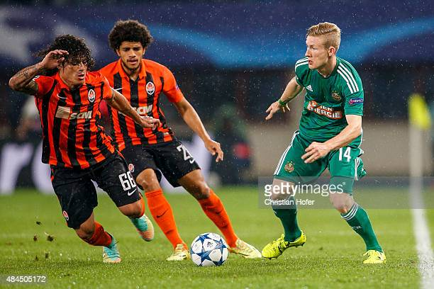 Marcio Azevedo and Taison of Donetsk compete for the ball with Florian Kainz of Vienna during the UEFA Champions League Qualifying Round Play Off...