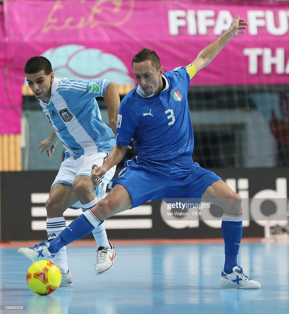 Marcio Forte of Italy tries to tackle Cristian Borruto of Argentina during the FIFA Futsal World Cup Thailand 2012, Group D match between Argentina and Italy at Nimibutr Stadium on November 5, 2012 in Bangkok, Thailand.
